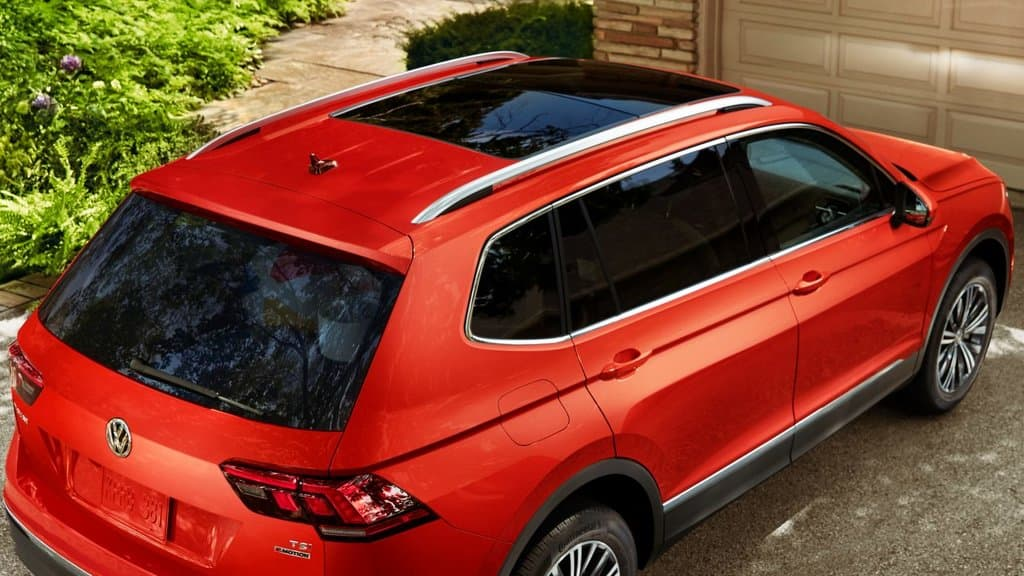 Rear exterior view of the 2018 Volkswagen Tiguan parked outside of a garage